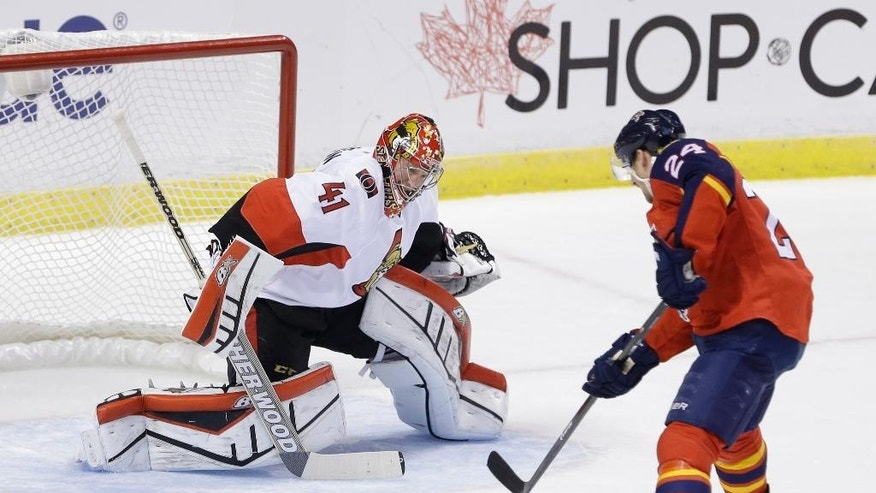 Florida Panthers right wing Brad Boyes (24) attempts a shot at Ottawa Senators goalie Craig Anderson (41) during the first period of an NHL hockey game, Monday, Oct. 13, 2014 in Sunrise, Fla. (AP Photo/Wilfredo Lee)