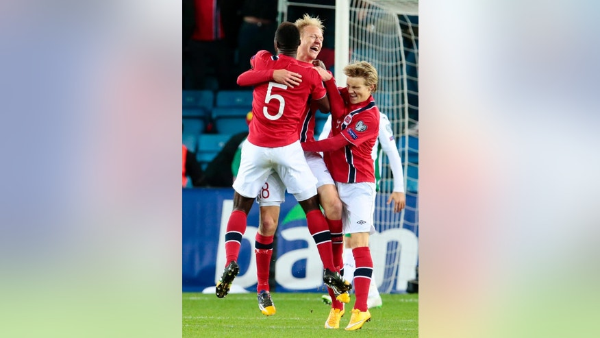 Norway's Haavard Nielsen, center, celebrates scoring with Alexander Tettey, left, and Martin Odegaard during the Euro 2016 qualifying group H soccer match between Norway and Bulgaria at Ullevaal Stadium in Oslo on Monday Oct. 13, 2014. (AP Photo/Haakon Mosvold Larsen, NTB Scanpix) NORWAY OUT