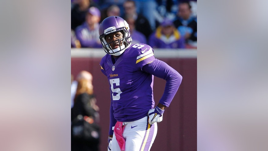 Minnesota Vikings quarterback Teddy Bridgewater (5) walks back to the sidelines during the closing minutes of the second half of an NFL football game against the Detroit Lions, Sunday, Oct. 12, 2014, in Minneapolis. Detroit defeated the Vikings 17-3. (AP Photo/Ann Heisenfelt)
