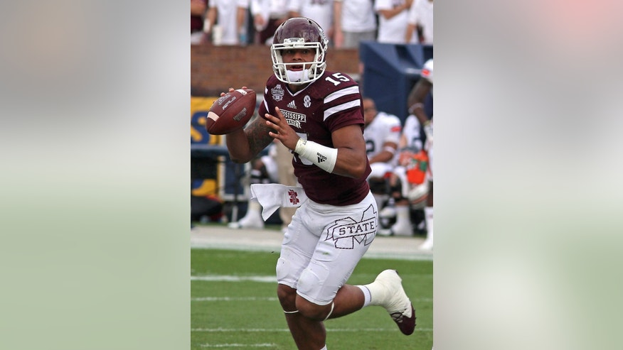 Mississippi State quarterback Dak Prescott (15) prepares to pass during the first half of an NCAA college football game against Auburn in Starkville, Miss., Saturday, Oct. 11, 2014. (AP Photo/Jim Lytle)