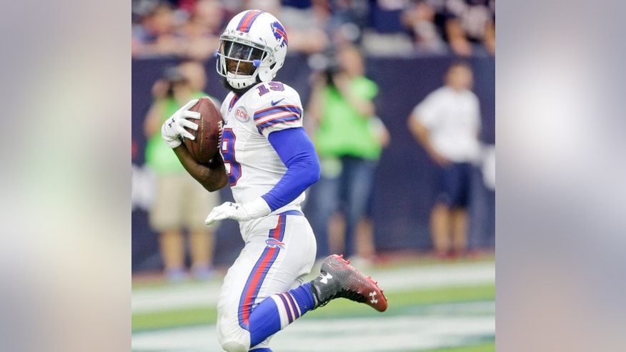 FILE - In this Sept. 28, 2014, file photo, Buffalo Bills' Mike Williams (19) scores a touchdown against the Houston Texans during the fourth quarter of an NFL football game in Houston. Bills General Manager Doug Whaley says he has granted the agent for wide receiver Mike Williams permission to seek a trade. Whaley said Monday, Oct. 13, 2014, that Williams' agent, Hadley Englehard, asked to gauge interest from other teams in a possible trade. (AP Photo/Patric Schneider, File)
