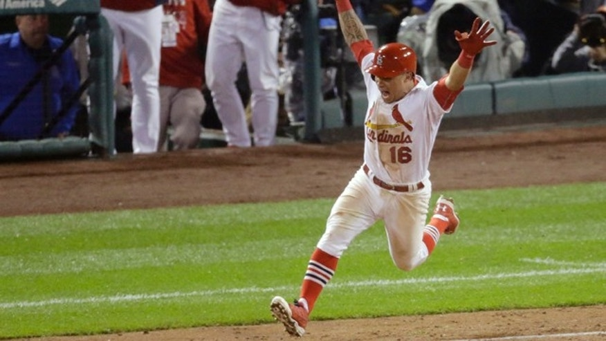October 12, 2014: St. Louis Cardinals' Kolten Wong celebrates after hitting a walk-off home run during the ninth inning in Game 2 of the National League baseball championship series against the San Francisco Giants. (AP Photo/Eric Gay)