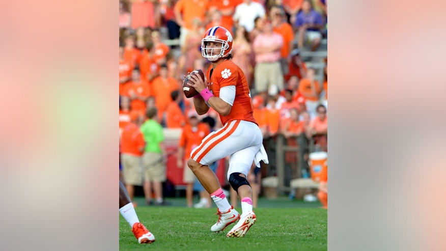 Clemson quarterback Cole Stoudt drops back to pass during an NCAA college football game against Louisville in Clemson, S.C.,  Saturday, Oct. 11, 2014. Clemson won 23-17. (AP Photo/ Richard Shiro)