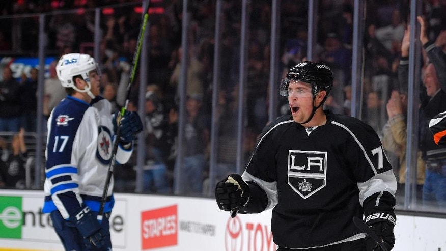 Los Angeles Kings left wing Tanner Pearson, right, celebrates his goal as Winnipeg Jets left wing Adam Lowry looks on during the second period of a NHL hockey game, Sunday, Oct. 12, 2014, in Los Angeles, Calif. (AP Photo/Mark J. Terrill)