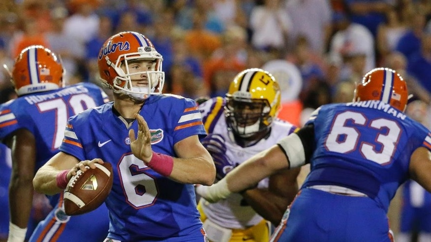 Florida quarterback Jeff Driskel (6) looks for a receiver against LSU during the first half of an NCAA college football game in Gainesville, Fla., Saturday, Oct. 11, 2014. (AP Photo/John Raoux)