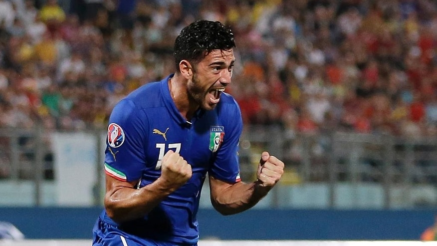Italy's Graziano Pelle celebrates after scoring during the Euro 2016 qualifying soccer match between Malta and Italy, at the National Stadium Ta' Qali, in Valletta, Malta, Monday, Oct. 13, 2014. (AP Photo/Antonio Calanni)