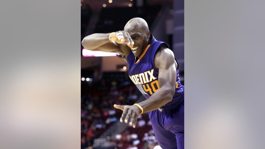 Phoenix Suns' Anthony Tolliver heads for the floor after being fouled by Houston Rockets' Jeff Adrien in the first half of an NBA basketball game Monday, Oct. 13, 2014, in Houston. (AP Photo/Pat Sullivan)