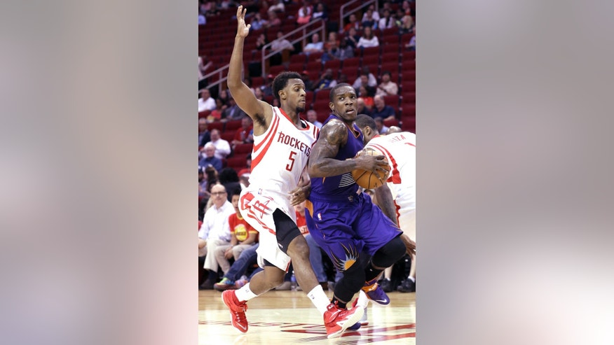 Phoenix Suns' Eric Bledsoe, right, is pressured by Houston Rockets' Ish Smith (5) in the first half of an NBA basketball game Monday, Oct. 13, 2014, in Houston. (AP Photo/Pat Sullivan)