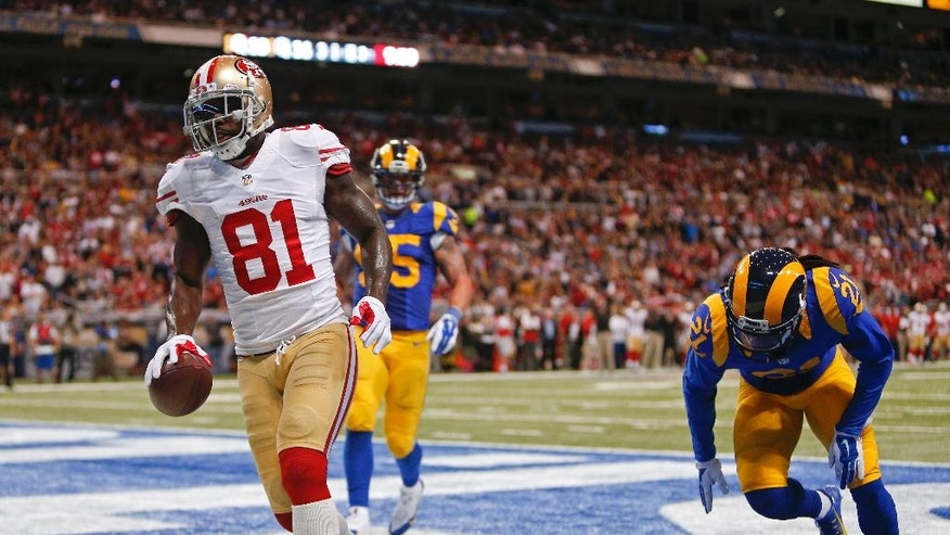 San Francisco 49ers wide receiver Anquan Boldin (81) scores a touchdown on an 11-yard pass play as he is defended by St. Louis Rams cornerback Janoris Jenkins (21) in the third quarter of an NFL football game Monday, Oct. 13, 2014, in St Louis. (AP Photo/Scott Kane)
