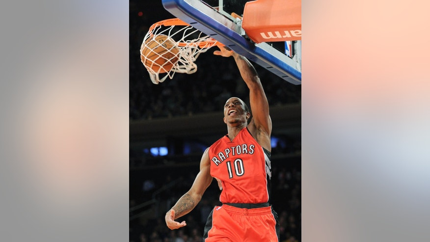 Toronto Raptors guard DeMar DeRozan dunks the ball during the first quarter of an NBA basketball game against the New York Knicks Monday, Oct. 13, 2014, at Madison Square Garden in New York. (AP Photo/Bill Kostroun)
