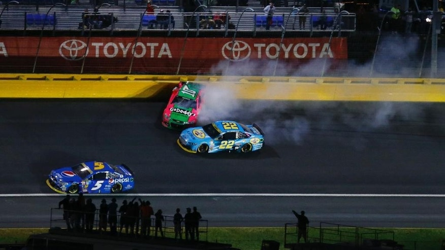 Danica Patrick (10) hits the wall between Turn 3 and 4 during the NASCAR Sprint Cup series Bank of America 500 auto race at Charlotte Motor Speedway in Concord, N.C., Saturday, Oct. 11, 2014. (AP Photo/Chris Keane)