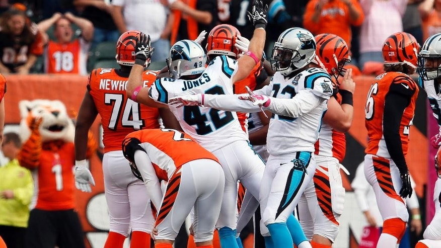 Cincinnati Bengals kicker Mike Nugent (2) reacts after missing a 36-yard field goal at the end of overtime of an NFL football game against the Carolina Panthers in Cincinnati Sunday, Oct. 12, 2014. The game ended in a 37-37 tie. (AP Photo/Paul Sancya)