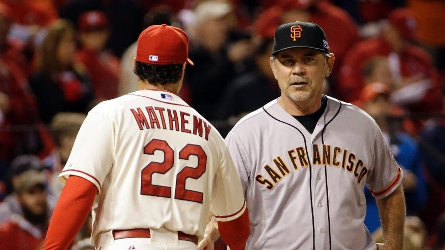 San Francisco Giants manager Bruce Bochy shakes hands with St. Louis Cardinals manager Mike Matheny (22) before Game 1 of the National League baseball championship series Saturday, Oct. 11, 2014, in St. Louis. (AP Photo/David J. Phillip)