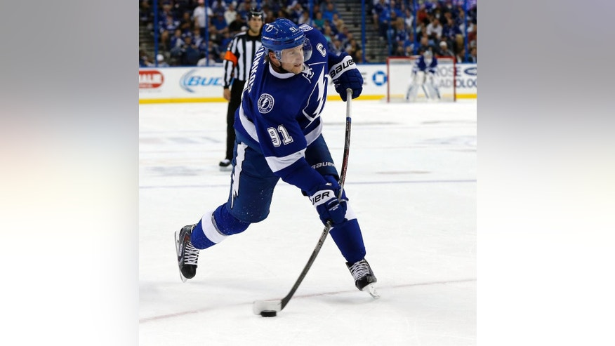 Tampa Bay Lightning's Steven Stamkos shoots to score his third goal of the game during the second period of an NHL hockey game against the Montreal Canadiens Monday, Oct. 13, 2014, in Tampa, Fla. (AP Photo/Mike Carlson)