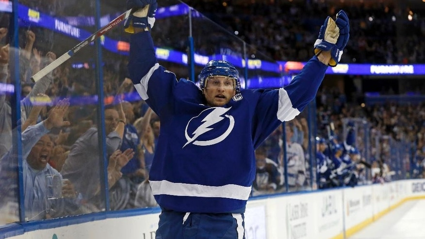 Tampa Bay Lightning's Steven Stamkos celebrates his third goal of the game against the Montreal Canadiens during the second period of an NHL hockey game Monday, Oct. 13, 2014, in Tampa, Fla. (AP Photo/Mike Carlson)