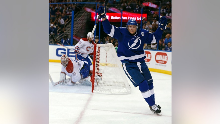 Tampa Bay Lightning's Steven Stamkos celebrates after scoring past Montreal Canadiens goalie Carey Price during the second period of an NHL hockey game Monday, Oct. 13, 2014, in Tampa, Fla. (AP Photo/Mike Carlson)