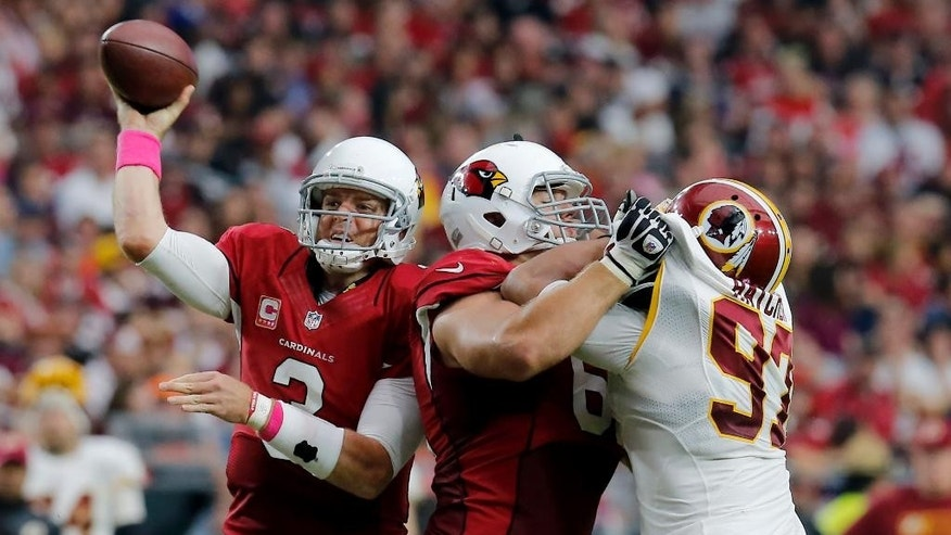 Arizona Cardinals quarterback Carson Palmer throws against the Washington Redskins during the second half of an NFL football game, Sunday, Oct. 12, 2014, in Glendale, Ariz.(AP Photo/Rick Scuteri)
