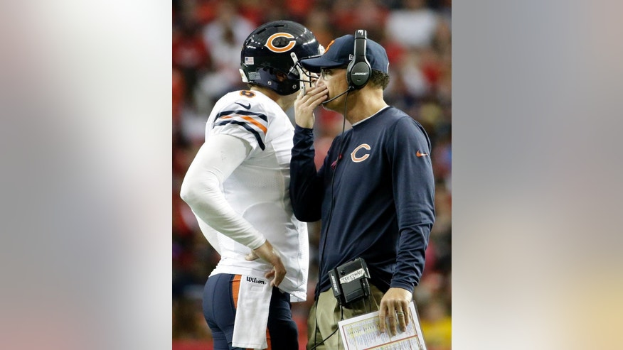 Chicago Bears head coach Marc Trestman speaks to Chicago Bears quarterback Jay Cutler (6) during the first half of an NFL football game against the Atlanta Falcons, Sunday, Oct. 12, 2014, in Atlanta. (AP Photo/David Goldman)