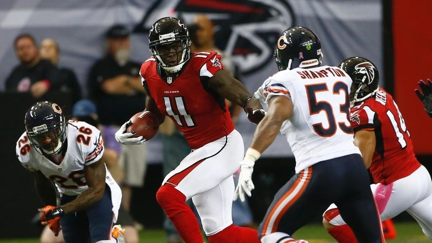 Atlanta Falcons wide receiver Julio Jones (11) runs against Chicago Bears Darryl Sharpton (53) during the first half of an NFL football game, Sunday, Oct. 12, 2014, in Atlanta. (AP Photo/John Bazemore)