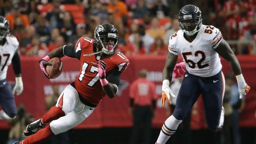 Atlanta Falcons wide receiver Devin Hester (17) runs past Chicago Bears outside linebacker Khaseem Greene (52) during the first half of an NFL football game, Sunday, Oct. 12, 2014, in Atlanta. (AP Photo/David Goldman)