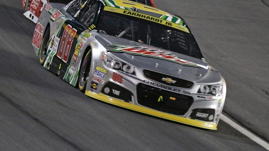 Dale Earnhardt Jr (88) leads Kevin Harvick (4) during the NASCAR Sprint Cup series Bank of America 500 auto race at Charlotte Motor Speedway in Concord, N.C., Saturday, Oct. 11, 2014. (AP Photo/Chuck Burton)