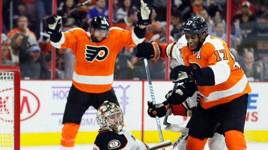 The Philadelphia Flyers' Jakub Voracek (93), rear, and Wayne Simmonds (17) right, react after the power play goal by Mark Streit on the Anaheim Ducks' Frederik Anderson (31) during the second period of an NHL hockey game  Tuesday, Oct. 14, 2014, in Philadelphia. (AP Photo/Tom Mihalek)
