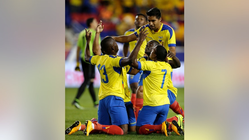 Ecuador players celebrate a goal by Enner Valencia (13) against El Salvador during the first half of an international soccer friendly match, Tuesday, Oct. 14, 2014, in Harrison, N.J. (AP Photo/Julio Cortez)