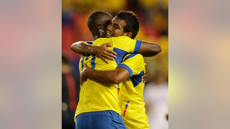 Ecuador's Enner Valencia, left, is hugged by teammate Junior Sornoza after Valencia scored a goal against El Salvador during the first half of an international soccer friendly match Tuesday, Oct. 14, 2014, in Harrison, N.J. (AP Photo/Julio Cortez)