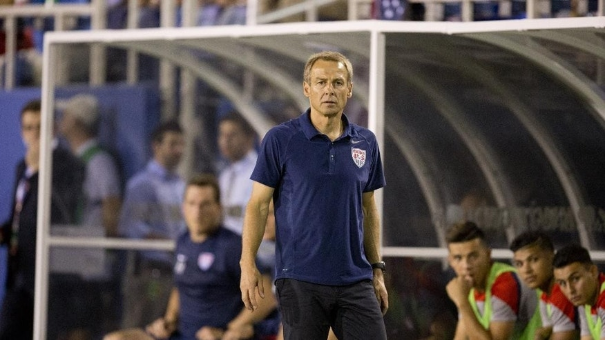 U.S. Nation Team coach Jurgen Klinsmann during the first half of  an international friendly  in Boca Raton, Fla.,  against Honduras, Tuesday, Oct. 14, 2014. (AP Photo/J Pat Carter)