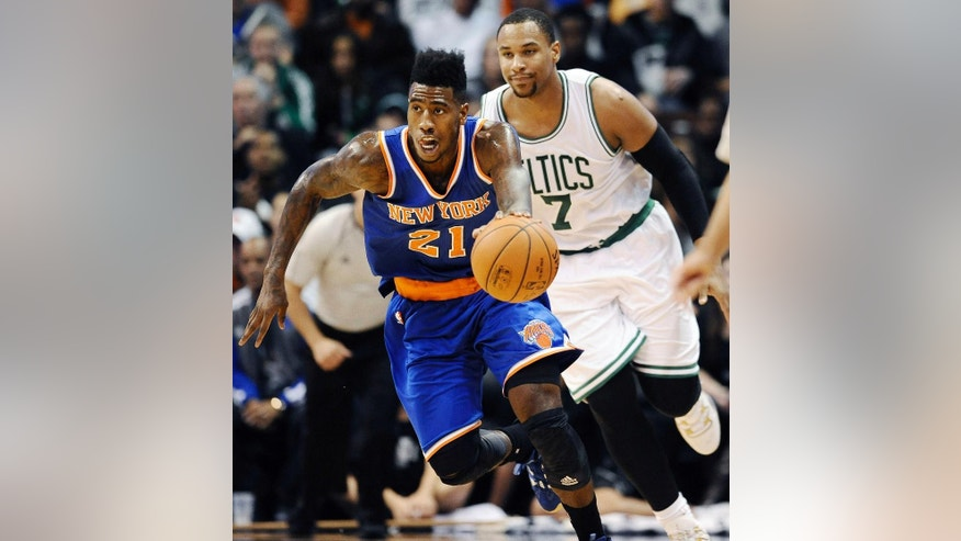 New York Knicks guard Iman Shumpert (21) dribbles the ball by Boston Celtics center Jared Sullinger (7) during the second half of a preseason NBA basketball game Saturday, Oct. 11, 2014, in Uncasville, Conn. The Knicks won 96-80. (AP Photo/Jessica Hill)