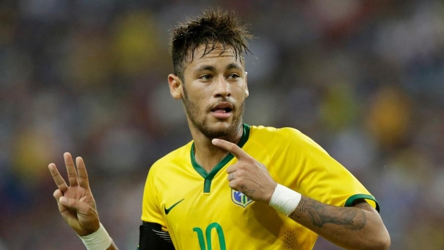 Brazil's Neymar gestures after scoring his third goal against Japan during an international friendly soccer match in Singapore, Tuesday, Oct. 14, 2014. (AP Photo/Wong Maye-E)