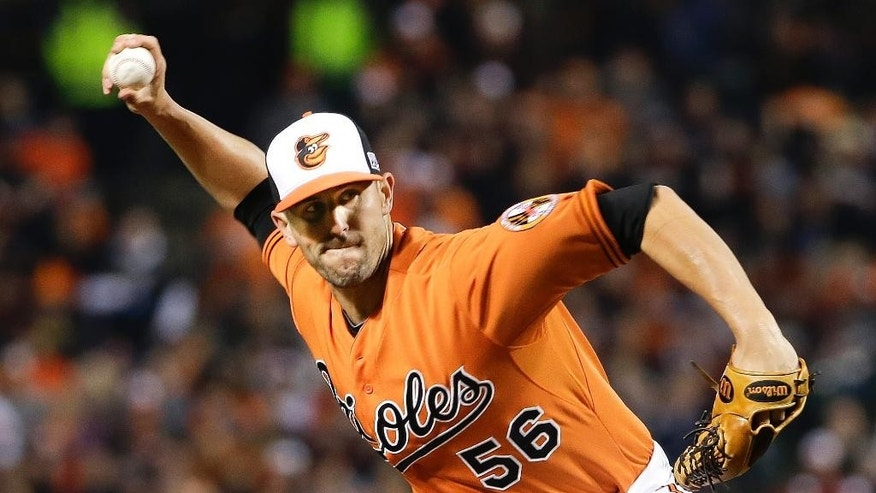 Baltimore Orioles relief pitcher Darren O'Day throws during the eighth inning of Game 2 of the American League baseball championship series against the Kansas City Royals Saturday, Oct. 11, 2014, in Baltimore. (AP Photo/Matt Slocum)