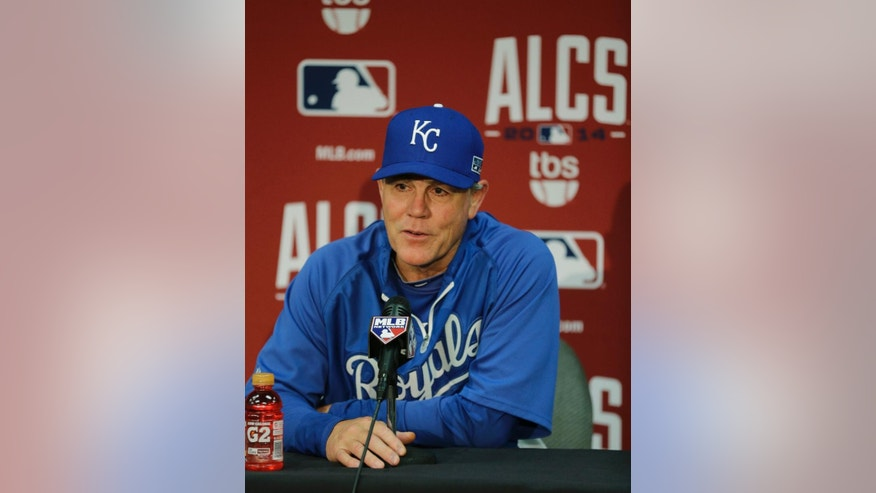 Kansas City Royals manager Ned Yost responds to a question during a news conference before Game 3 of the American League baseball championship series against the Baltimore Orioles Monday, Oct. 13, 2014, in Kansas City, Mo. Game 3 was postponed till Tuesday due to heavy rain that is expected to fall in Kansas City tonight.(AP Photo/Chris O'Meara)