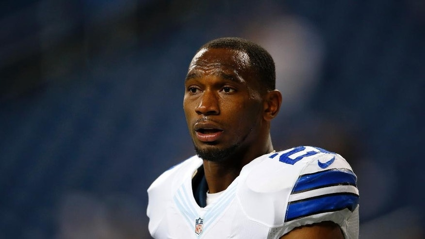 FILE - This is an Oct. 27, 2013, file photo showing Dallas Cowboys running back Joseph Randle watching during warmups before an NFL football game against the Detroit Lions in Detroit. Police in suburban Dallas say Randle has been arrested after taking underwear and cologne from a mall department store without paying. Frisco Police Sgt. Brad Merritt says Randle is charged with Class B misdemeanor theft. He was detained Monday evening, Oct. 13, 2014, by store security before being arrested and booked into the Frisco city jail. Merritt says Randle posted bond early Tuesday. (AP Photo/Paul Sancya, File)
