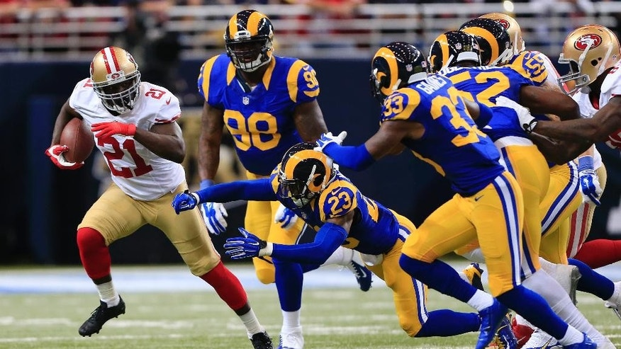 San Francisco 49ers running back Frank Gore (21) gets past St. Louis Rams free safety Rodney McLeod (23) in the first quarter of an NFL football game Monday, Oct. 13, 2014, in St Louis. (AP Photo/Billy Hurst)