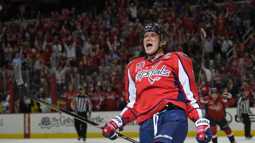 Washington Capitals left wing Alex Ovechkin, of Russia, celebrates his goal against the San Jose Sharks during the second period of an NHL hockey game, Tuesday, Oct. 14, 2014, in Washington. (AP Photo/Nick Wass)