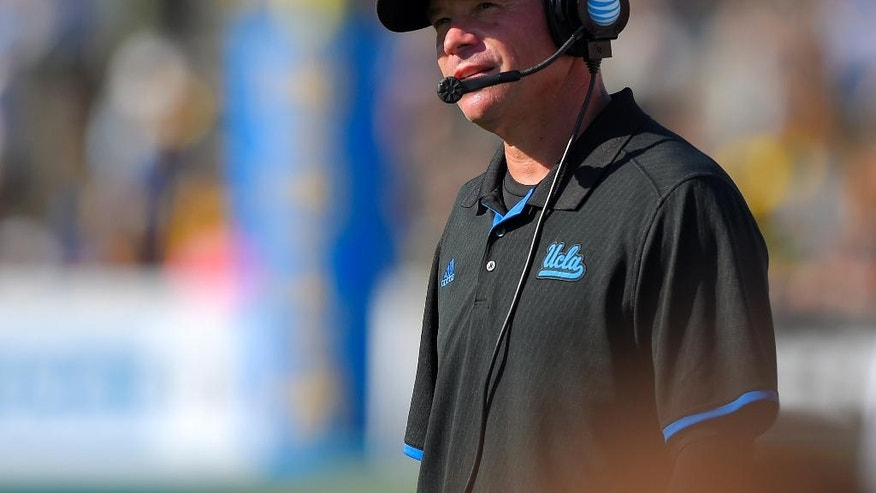 UCLA head coach Jim Mora looks on during the second half of a NCAA college football game against Oregon, Saturday, Oct. 11, 2014, in Pasadena, Calif. Oregon won 42-30. (AP Photo/Mark J. Terrill)