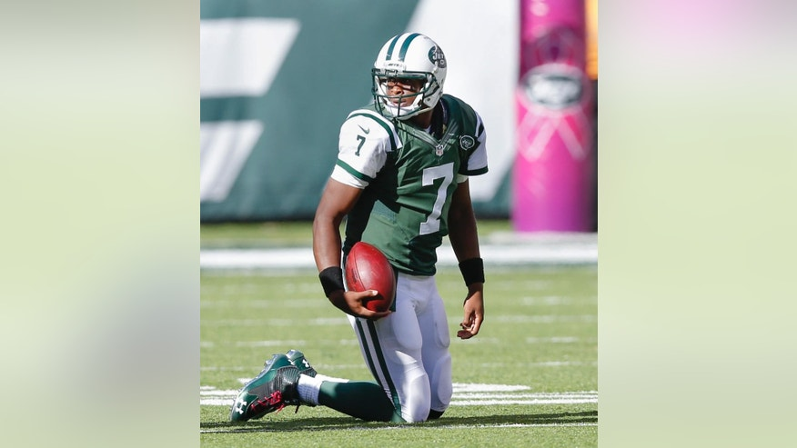 New York Jets quarterback Geno Smith (7) gets up off the turf after a sack from the Denver Broncos during the third quarter of an NFL football game, Sunday, Oct. 12, 2014, in East Rutherford, N.J. (AP Photo/Kathy Willens)