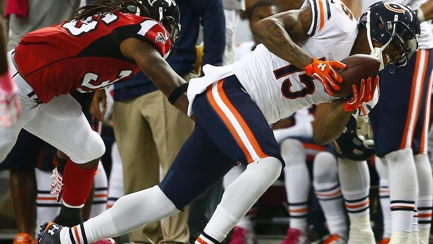 Chicago Bears wide receiver Brandon Marshall (15) makes a catch against Atlanta Falcons defensive back Kemal Ishmael (36) during the first half of an NFL football game, Sunday, Oct. 12, 2014, in Atlanta. (AP Photo/John Bazemore)