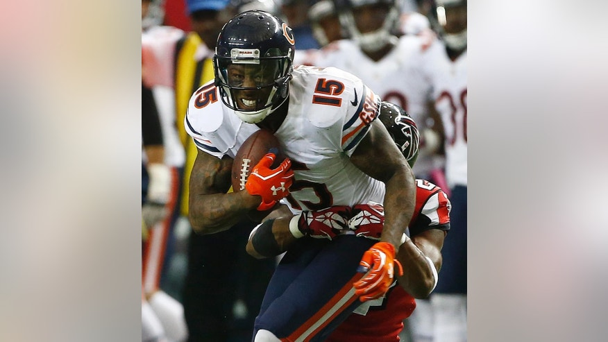 Atlanta Falcons cornerback Robert McClain (27) tackles Chicago Bears wide receiver Brandon Marshall (15) during the first half of an NFL football game, Sunday, Oct. 12, 2014, in Atlanta. (AP Photo/John Bazemore)