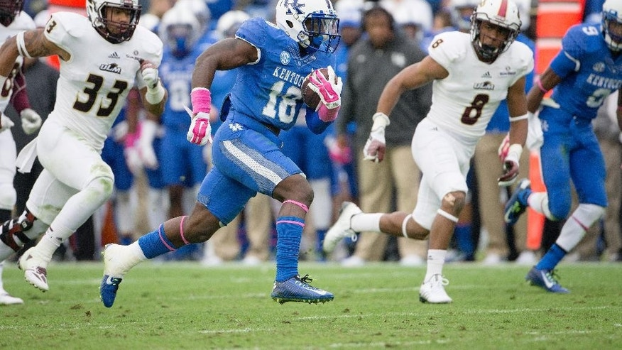 Kentucky running back Stanley Williams runs 58 yards for a touchdown during the second half of an NCAA college football game against Louisiana Monroe in Lexington, Ky., Saturday, Oct. 11, 2014. Kentucky won the game 48-14.  (AP Photo/David Stephenson)