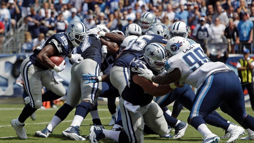 FILE - In this Sept. 14, 2014, file photo, Dallas Cowboys running back DeMarco Murray (29) moves though the line to score a touchdown on a 3-yard run against the Tennessee Titans in the second quarter of an NFL football game  in Nashville, Tenn. Blocking Titans' defensive end Jurrell Casey (99) is Cowboys' center Travis Frederick (72). Tyron Smith, Travis Frederick and Zack Martin are 23-year-old first-round draft picks anchoring the Dallas offensive line for NFL rushing leader DeMarco Murray. (AP Photo/Wade Payne, File)