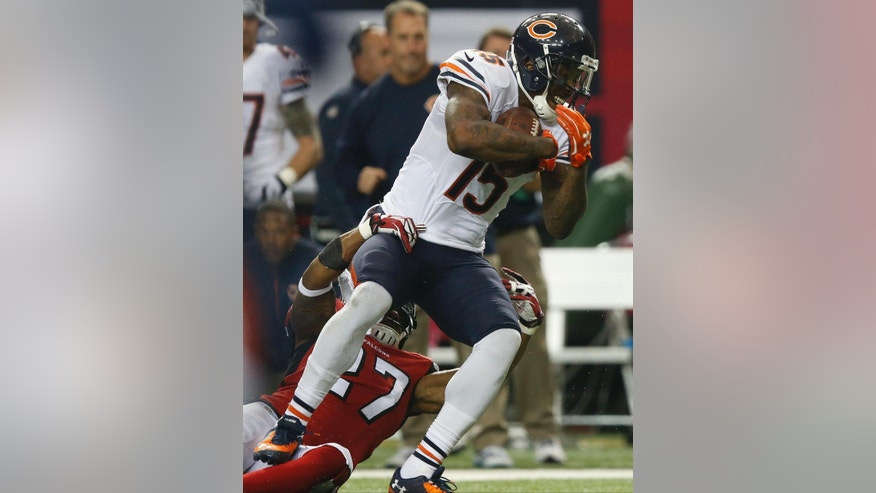 Chicago Bears wide receiver Brandon Marshall (15) works against Atlanta Falcons cornerback Robert McClain (27) during the first half of an NFL football game, Sunday, Oct. 12, 2014, in Atlanta. (AP Photo/Brynn Anderson )