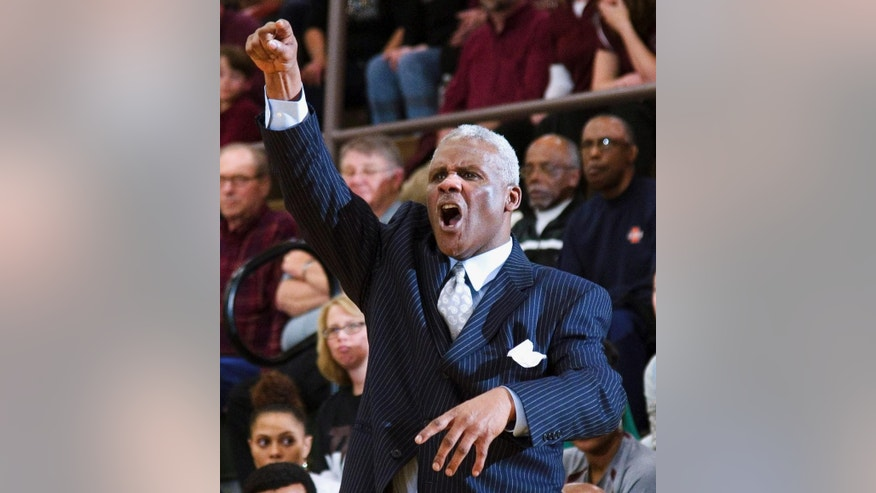 In a  March 11, 2014, photo, Champaign Central High School head coach Wayne McClain cheers during a game at Mattoon High School in Mattoon, Ill. McClain, a former assistant basketball coach for the University of Illinois from 2002 through 2012, died Wednesday, Oct. 15, 2014, at a local hospital after an unspecified illness. He was 59. (AP Photo/The News-Gazette, Robin Scholz) MANDATORY CREDIT