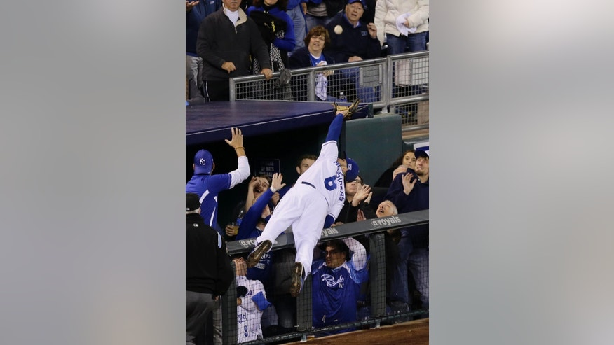 Kansas City Royals third baseman Mike Moustakas makes a catch on a ball hit by Baltimore Orioles' Adam Jones during the sixth inning of Game 3 of the American League baseball championship series Tuesday, Oct. 14, 2014, in Kansas City, Mo. (AP Photo/Chris O'Meara)