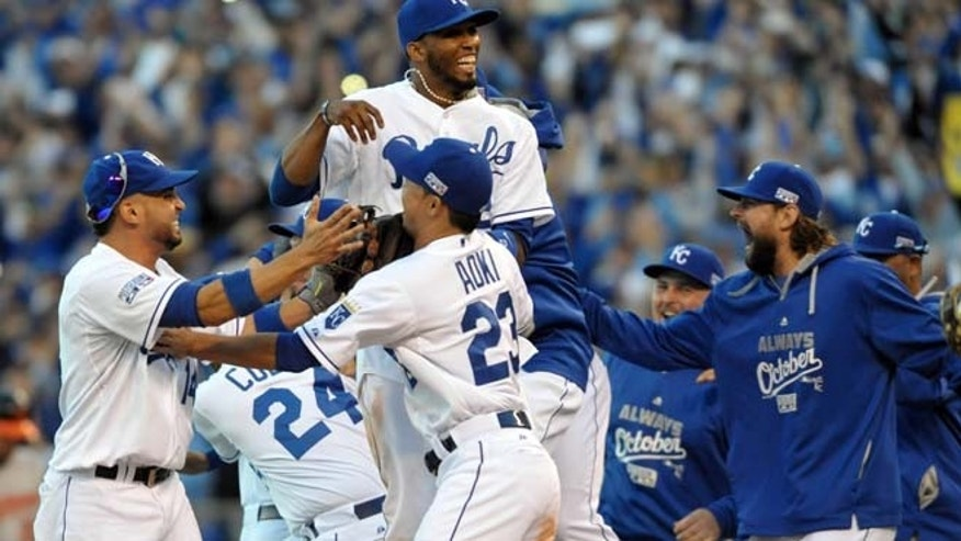 Oct 15, 2014: Kansas City Royals players celebrate on the field after defeating the Baltimore Orioles in game four of the 2014 ALCS playoff baseball game at Kauffman Stadium.