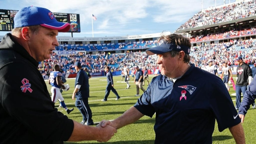 Buffalo Bills head coach Doug Marrone, left, shakes hands with New England Patriots head coach Bill Belichick, right, after an NFL football game Sunday, Oct. 12, 2014, in Orchard Park, N.Y. The Patriots won the game 37-22. (AP Photo/Mike Groll)