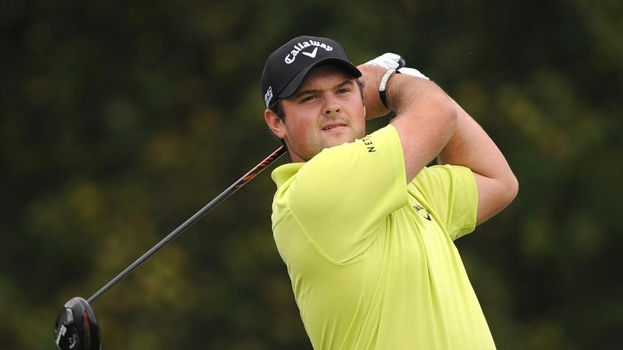U.S. golfer Patrick Reed   plays a tee-shot during day one of the World Match Play Championship at The London Club, in Ash southeast England Wednesday Oct. 15, 2014. (AP Photo/Nigel French/PA) UNITED KINGDOM OUT