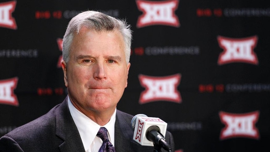 Kansas State coach Bruce Weber talks about his team's upcoming NCAA men's college basketball season during the Big 12 Conference Media Day event at the Sprint Center in Kansas City, Mo., Wednesday, Oct. 15, 2014. (AP Photo/Colin E. Braley)
