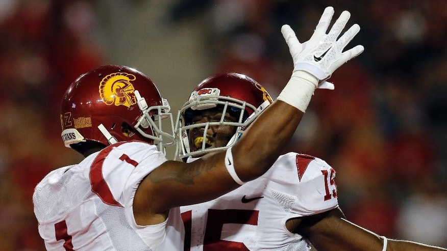Southern California wide receiver Nelson Agholor (15) celebrates with Darreus Rogers (1)  after scoring a touchdown during the second half of an NCAA college football game against Arizona, Saturday, Oct. 11, 2014, in Tucson, Ariz. (AP Photo/Rick Scuteri)